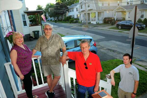 Darina Place residents Debbie and Carl Kaufman, left, stand with neighbors Mark Hoffman and Tim Cotter at the Kaufman home this week. The neighbors are pushing the city to make Darina Place a one-way street.