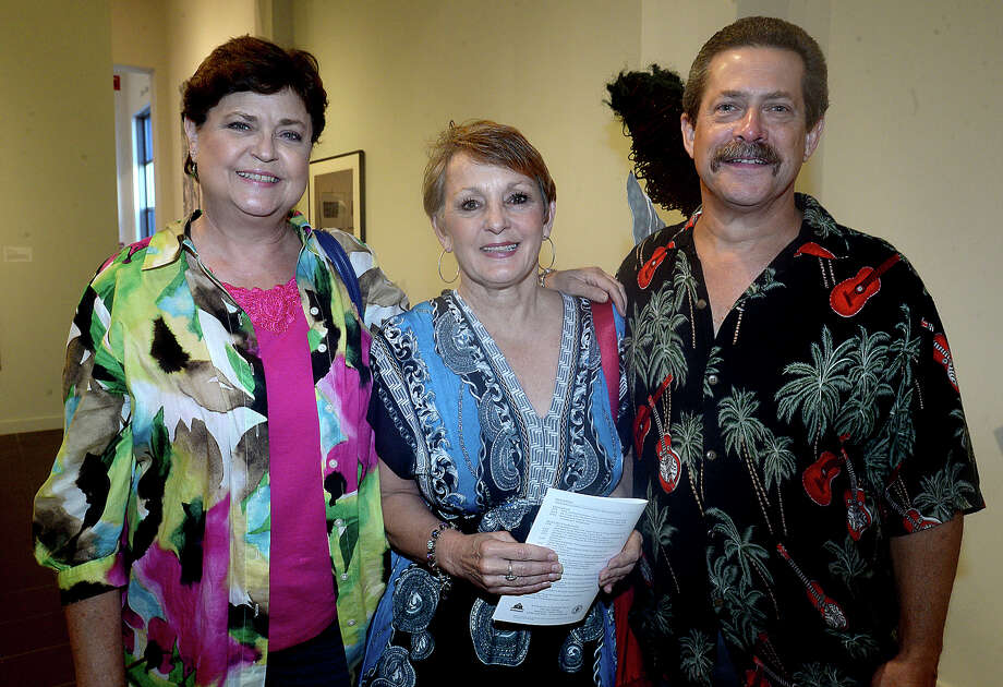 Pam Lewis, Debbie Loftus, and Jimmie Lewis were at the opening reception for the Tete-a-Tete folk art exhibit and works by Teresa Baker at the Art Museum of Southeast Texas Friday. A reception was also held at the High Street Gallery at Victoria House for a photography exhibit by Randy Edwards. Photo taken Friday, June 24, 2016 Kim Brent/The Enterprise Photo: Kim Brent / Beaumont Enterprise