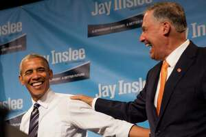 President Barack Obama and Governor Jay Inslee laugh following their speeches at a Democratic fundraiser at the Washington State Convention Center on Friday, June 24, 2016.