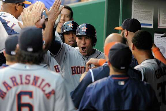George Springer is the center of attention for good reason in the Astros' dugout. The outfielder followed a first-inning triple with a grand slam later in the nine-run inning Friday night. He became the first leadoff hitter to slug a first-inning slam in more than 30 years.