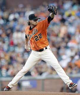 San Francisco Giants starting pitcher Jake Peavy throws to the Philadelphia Phillies during the first inning of a baseball game Friday, June 24, 2016, in San Francisco. (AP Photo/Marcio Jose Sanchez)