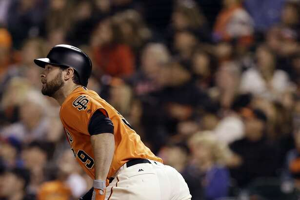San Francisco Giants' Brandon Belt watches his three-run double against the Philadelphia Phillies during the seventh inning of a baseball game Friday, June 24, 2016, in San Francisco. (AP Photo/Marcio Jose Sanchez)