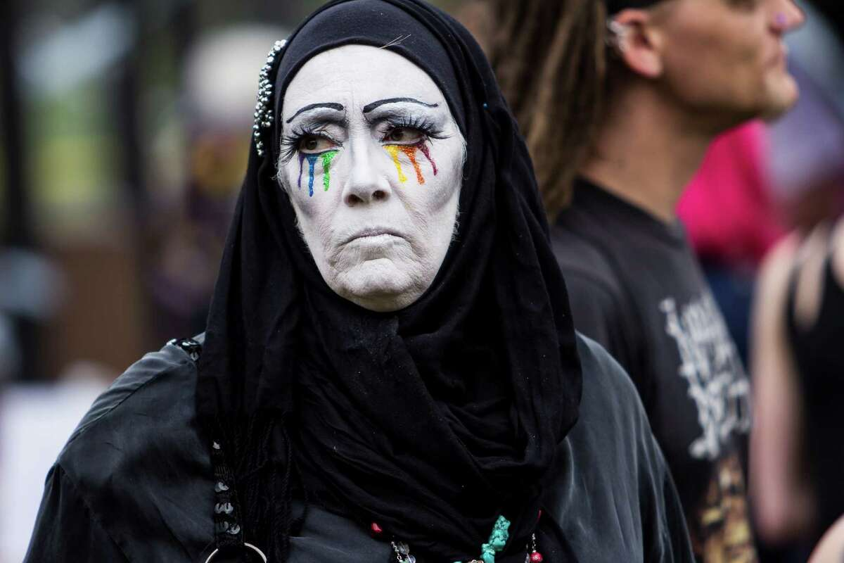 Postulate Dolly Mama of the Sisters of Perpetual Indulgence surveys the crowd in Cal Anderson Park during Trans Pride in Capitol Hill on June 24, 2016.