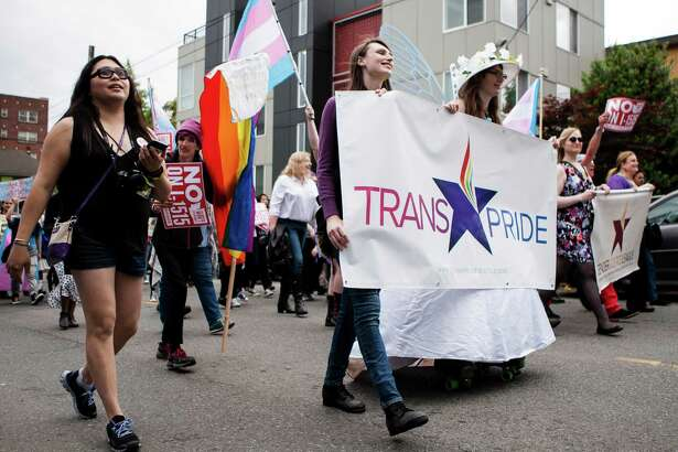 Members of the LGBTQ and allied community march during the Trans Pride March on Capitol Hill in downtown Seattle on June 24, 2016.