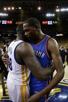 OAKLAND, CA - MAY 30:  Kevin Durant #35 of the Oklahoma City Thunder hugs Draymond Green #23 of the Golden State Warriors after losing 96-88 in Game Seven of the Western Conference Finals during the 2016 NBA Playoffs at ORACLE Arena on May 30, 2016 in Oakland, California. NOTE TO USER: User expressly acknowledges and agrees that, by downloading and or using this photograph, User is consenting to the terms and conditions of the Getty Images License Agreement.  (Photo by Ezra Shaw/Getty Images)