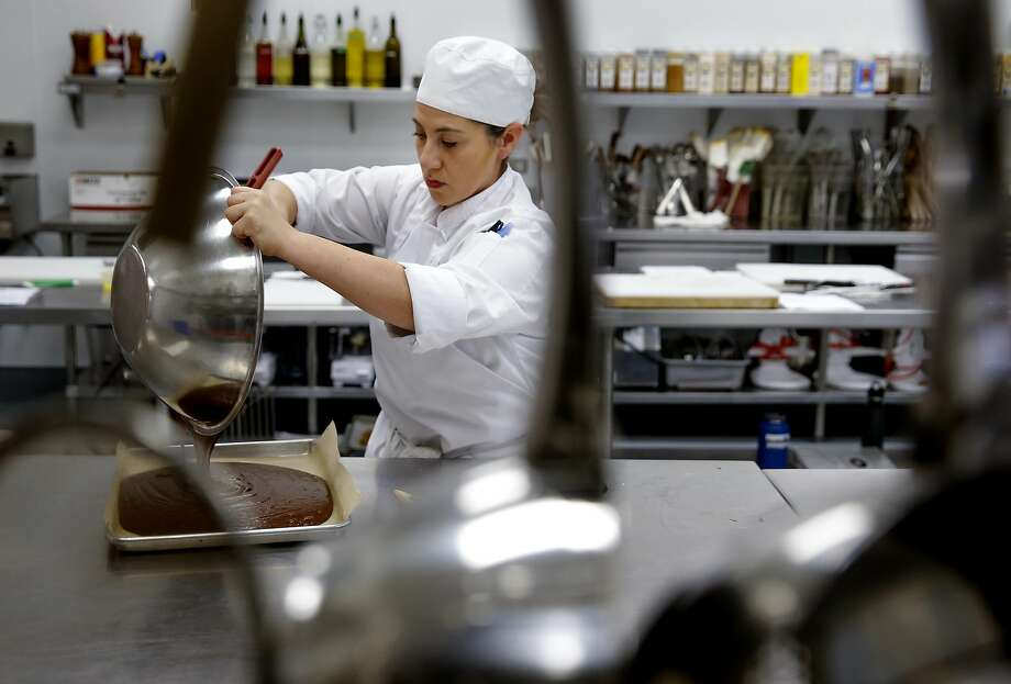 Student Gina DeMartini makes chocolate brownies during class at the school. Photo: Michael Macor, The Chronicle