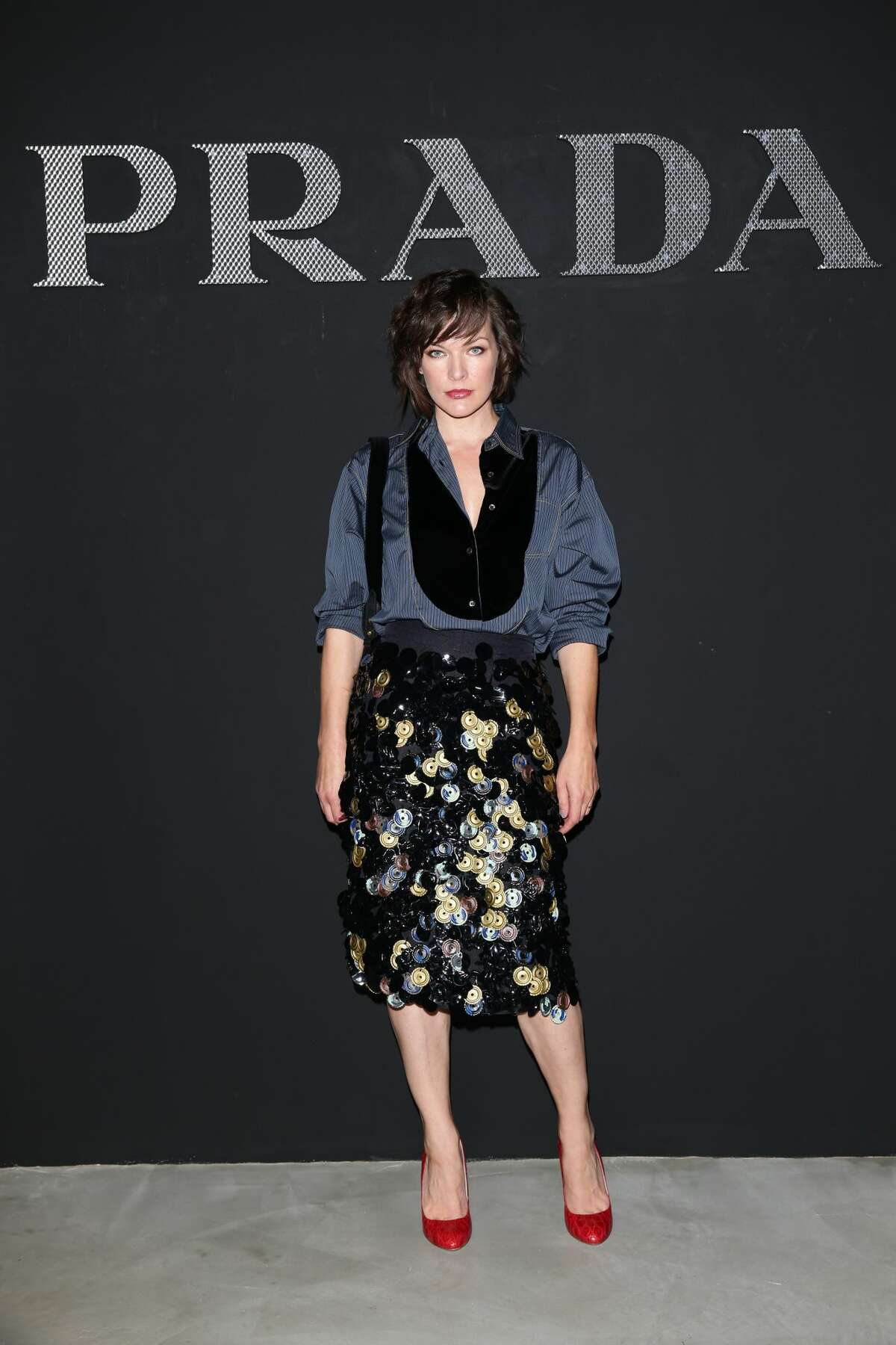 Best: Milla Jovovich knows how to accesorize a sequined skirt at the Prada show in Milan.