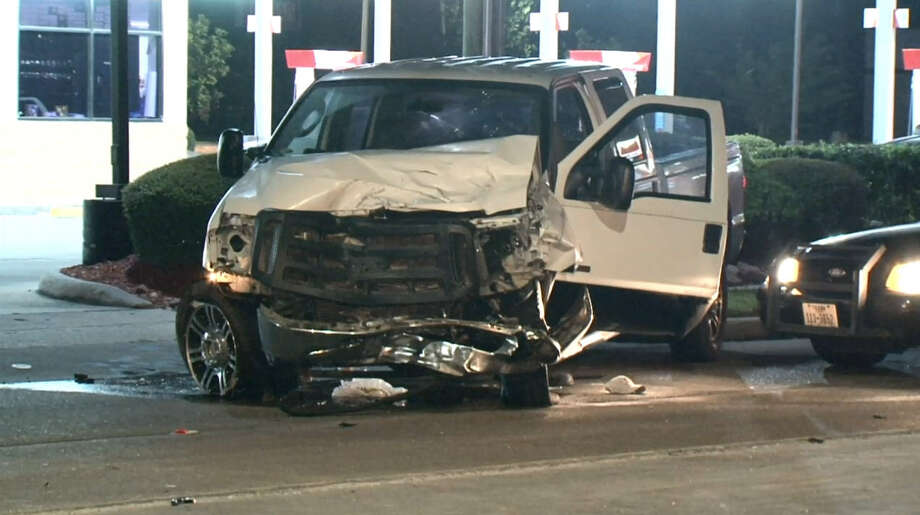 A Houston police chase that ended in northeast Houston on Friday night left one innocent motorist injured and at least two men in handcuffs on Friday June 24, 2016. Photo: Metro Video