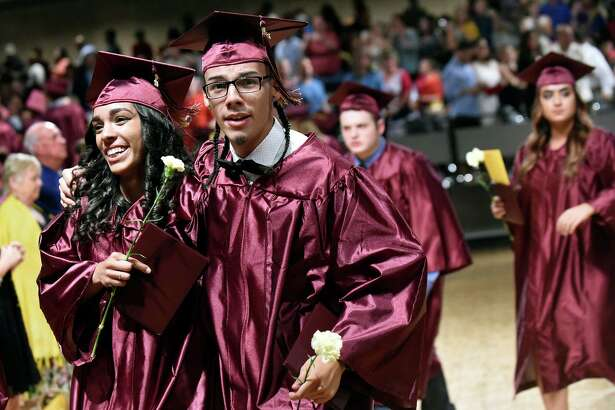 Twin graduates Justine Febres, left, and Justin Febres, center, embrace the moment after Colonie High commencement exercises on Friday, June 24, 2016, at Empire State Plaza Convention Center in Albany, N.Y. (Cindy Schultz / Times Union)