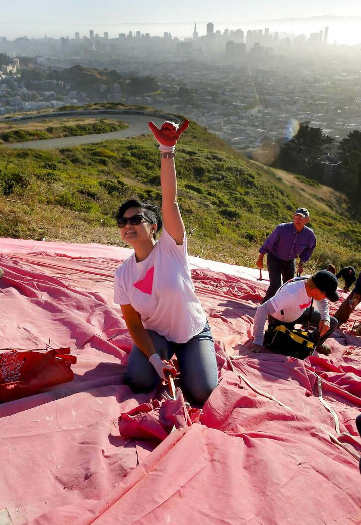 Volunteer Melanie Buntichai at work during the annual installation of the Pink Triangle on Twin Peaks overlooking San Francisco, California on Sat. June 25, 2016