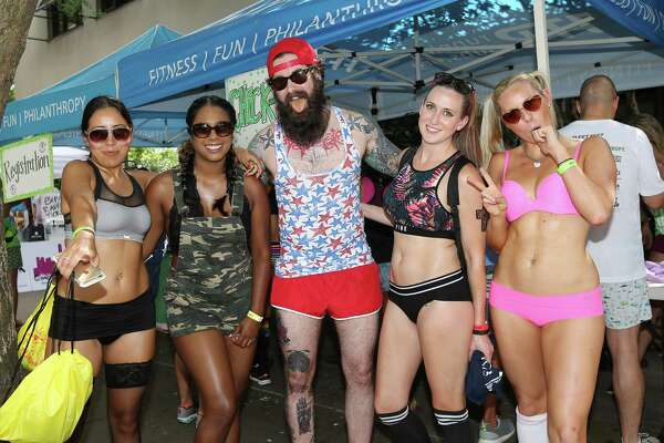 People pose for a photo at the Hot Undies Run, Saturday, June 25, 2016, in Houston.