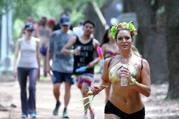 Andrea Prigmore runs along Rice Boulevard during the Hot Undies Run, Saturday, June 25, 2016, in Houston.