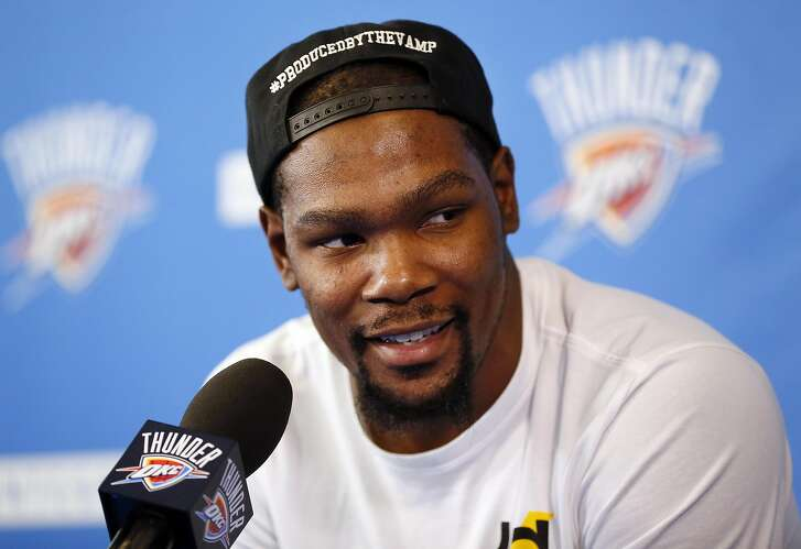 """Oklahoma City's Kevin Durant (35) speaks during a news conference at the team's practice facility in Oklahoma City, Wednesday, June 1, 2016. Durant, the face of the Oklahoma City franchise since its move from Seattle in 2008 is heading into free agency, and what he chooses to do could shake up the NBA landscape. Durant said Wednesday that he has not yet """"wrapped"""" his mind around the idea of being a free agent. (Nate Billings/The Oklahoman via AP) LOCAL STATIONS OUT (KFOR, KOCO, KWTV, KOKH, KAUT OUT); LOCAL WEBSITES OUT; LOCAL PRINT OUT (EDMOND SUN OUT, OKLAHOMA GAZETTE OUT) TABLOIDS OUT; MANDATORY CREDIT"""