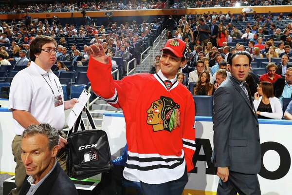 BUFFALO, NY - JUNE 25:  Chad Krys reacts after being selected 45th by the Chicago Blackhawks during the 2016 NHL Draft on June 25, 2016 in Buffalo, New York.  (Photo by Bruce Bennett/Getty Images)