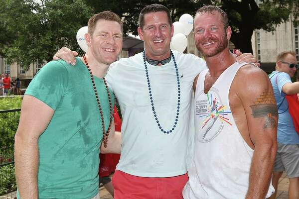 People pose for a photo at the 2016 Houston Pride Festival, Saturday, June 25, 2016, in Houston.