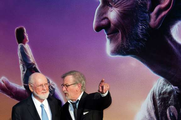 "Composer John Williams (L) and director/producer Steven Spielberg attend the premiere of Disney's ""The BFG"" at El Capitan in Hollywood, California, June 21, 2016. / AFP PHOTO / VALERIE MACONVALERIE MACON/AFP/Getty Images"