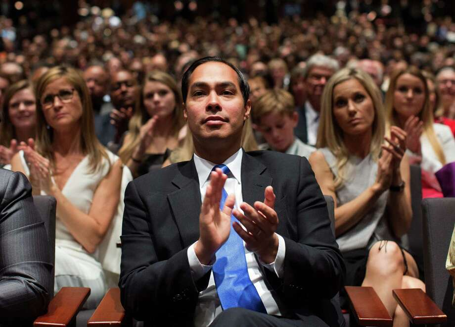 FILE -- Julian Castro, the Housing and Urban Development secretary, applauds President Barack ObamaÕs remarks during a civil rights summit in Austin, Texas, April 10, 2014. Castro, a former mayor of San Antonio considered a rising star in the Democratic Party, is reportedly on the short list of names Hillary ClintonÕs campaign is considering as a potential running mate. (Doug Mills/The New York Times) Photo: DOUG MILLS, STF / NYT / NYTNS