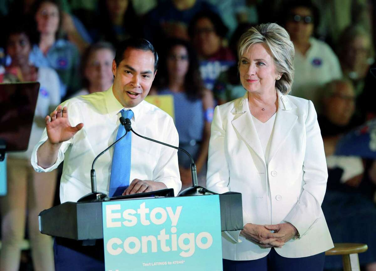 In this Oct. 15, 2015 file photo, Housing and Urban Development Secretary Julian Castro, left, speaks during a campaign event for Democratic presidential candidate Hillary Rodham Clinton, right, in San Antonio. Castro is returning home Friday, June 17, 2016, swarmed by the same speculation about whether he could be Hillary Clinton's running mate this fall. (AP Photo/Eric Gay, File)