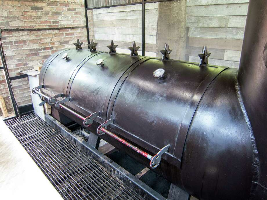 Tejas Chocolate Craftory's offset barrel smoker is mostly exposed to the elements. Photo: J.C. Reid