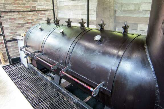 Tejas Chocolate Craftory's offset barrel smoker is mostly exposed to the elements.