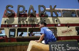 Lucca Betencourt, 3 of San Francisco explores the climbing logs out front as a new food truck park called Spark has opened in the middle of the Mission Bay neighborhood today in San Francisco, California on Sat. June 25, 2016.