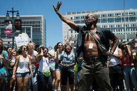 Cornelius Washington dances during a Pride celebration at the Civic Center Plaza in San Francisco, Calif. on Saturday, June 25, 2016. Artists such as Jessica Sutta, AB Soto, JES and Shaun J. Wright performed for San Francisco Pride attendees.