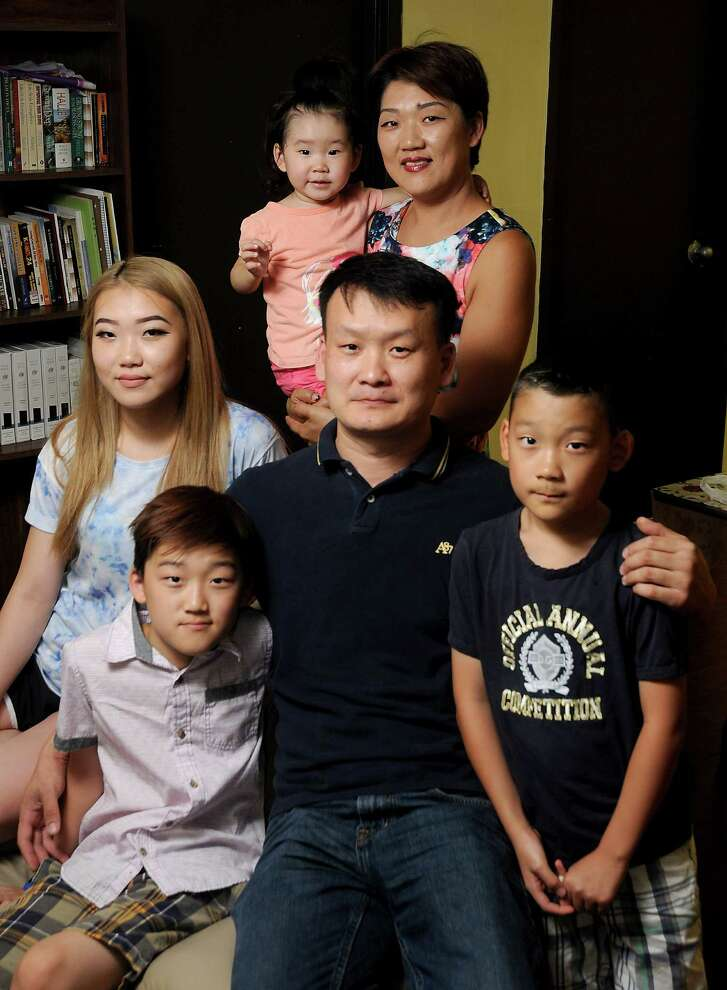 Viktor Lim with his wife, Radmila, and their children Grace,15; Elijah, 10; Max, 9; and Yuna, 2, attend the Korean Presbyterian Church of Houston.