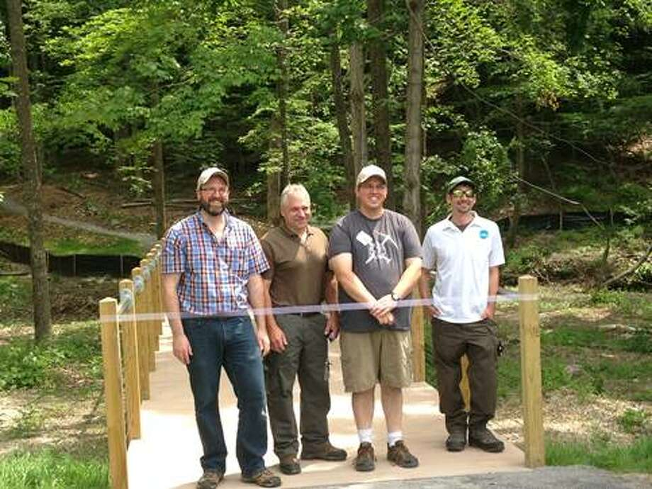 From left, Jeff Senterman, Catskill Center, Jeff Ryder, of the state DEC, Doug Senterman of NY NJ Trail Conference and Ian Dunn of the DEC attend a June 4 grand opening of the Nature Trail at the Maurice D. Hinchey Catskill Interpretive Center (CIC) in Mount Tremper (Rosalind Dickinson)