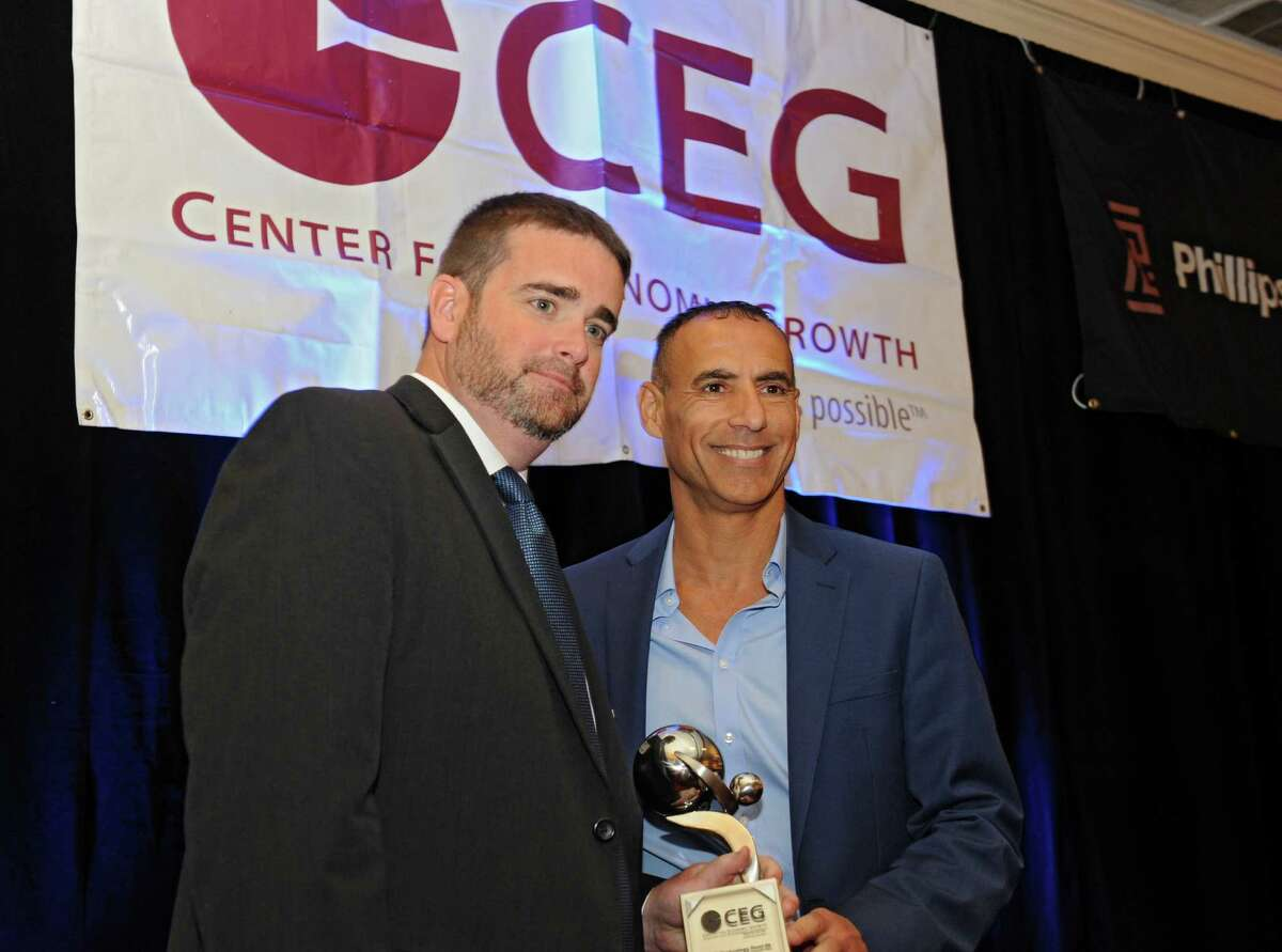 Richard Honen of Phillips Lyle, right, accepts the JeffreyA. Lawrence Lifetime Contributor award from Andrew Kennedy, president and CEO of Center for Economic Growth during CEG's annual awards luncheon at the Desmond Hotel on Thursday, June 23, 2016 in Colonie, N.Y. (Lori Van Buren / Times Union)