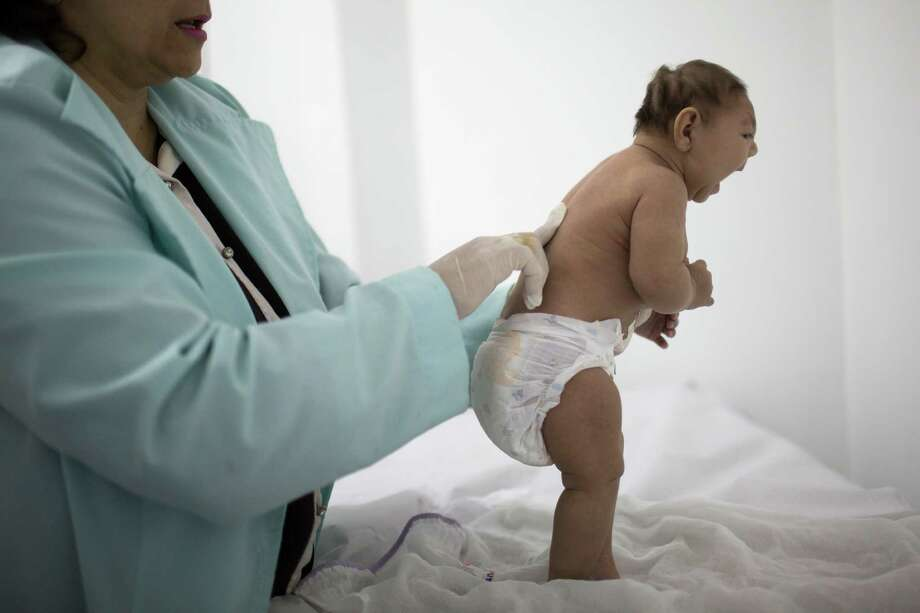 Will defeat of Zika funding bill Tuesday lead to U.S. babies, like this  one in Brazil, born with an abnormally small head? Congressional leaders  on both sides of the aisle blamed politics if that turns out to be the case. Photo: Felipe Dana, STF / AP