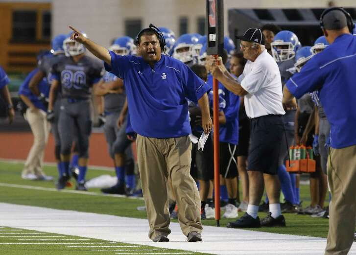 Jay head football coach Gary Gutierrez calls out to his team to take the field against Del Rio at Gustafson Stadium on Sept. 11, 2015.