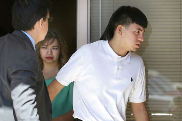Jay High School football player Victor Rojas leaves the NISD headquarters after a hearing on Sept. 23, 2015.