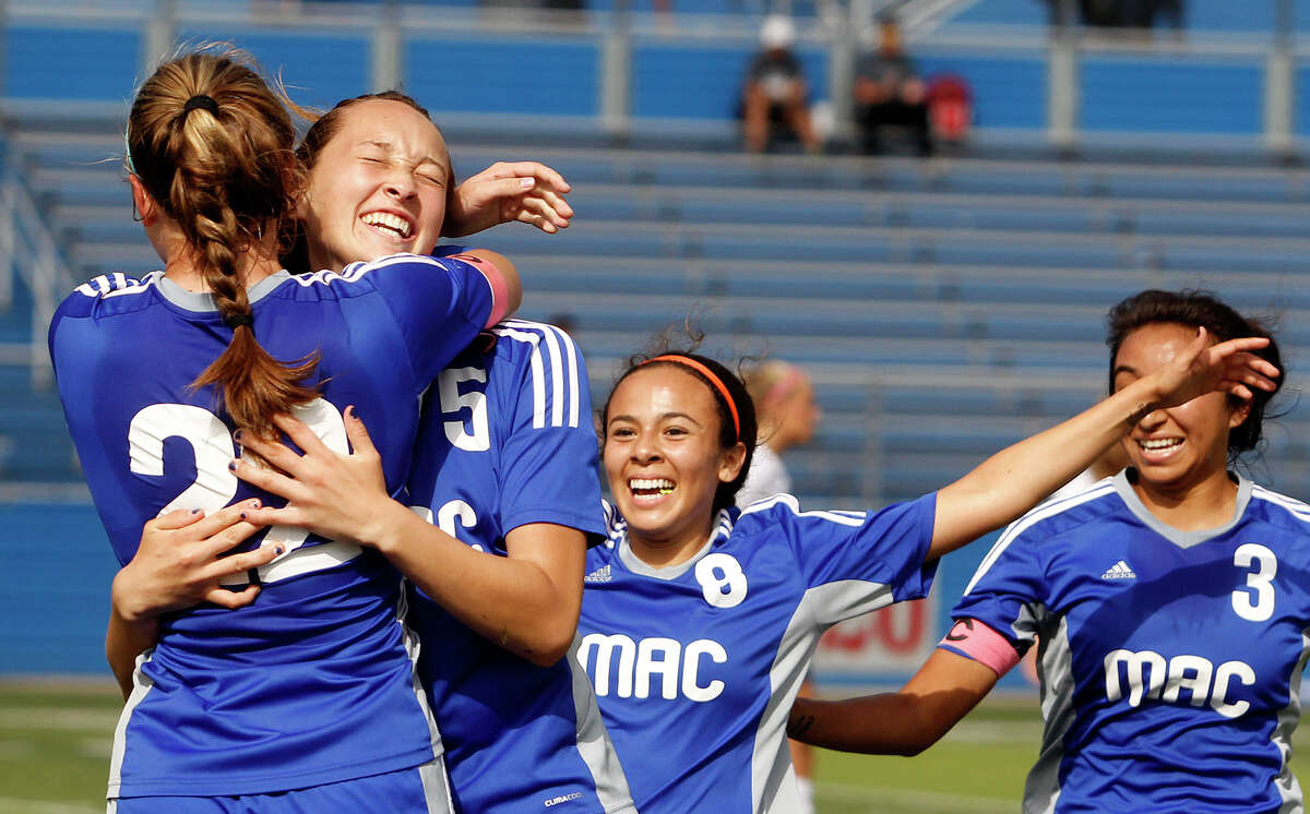 MacArthur's Kyra Falcone (22) hugs Isabella Von Toussaint as they celebrate a goal with Analisa Pompa (8) and Ana Campa (3) during the UIL 6A girls state semifinal soccer game in Georgetown on April 15, 2016.