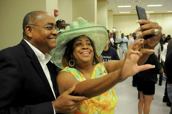 Candidate Rodney Ellis takes a selfie with Nata Koerber before a meeting of Harris County Precinct 1 Chairs at CWA Local 6222 downtown Saturday June 25,2016.(Dave Rossman Photo)