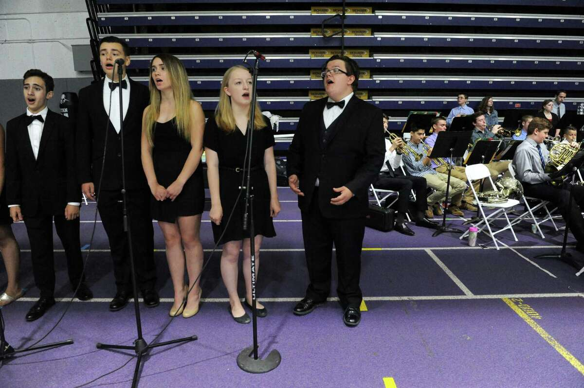 The Shaker Select choir performs the national anthem during the 2016 Shaker High School graduation at the UAlbany SEFCU Arena on Saturday June 25, 2016 in Albany, N.Y. (Michael P. Farrell/Times Union)