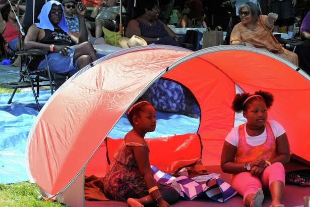 Jayla Batchelor, nine-years-old and her sister Ayanna, ten-years-old, of Florida keep cool in a tent during the 39th Freihofer's Saratoga Jazz Festival on Saturday June 25, 2016 in Saratoga Springs, N.Y. (Michael P. Farrell/Times Union)