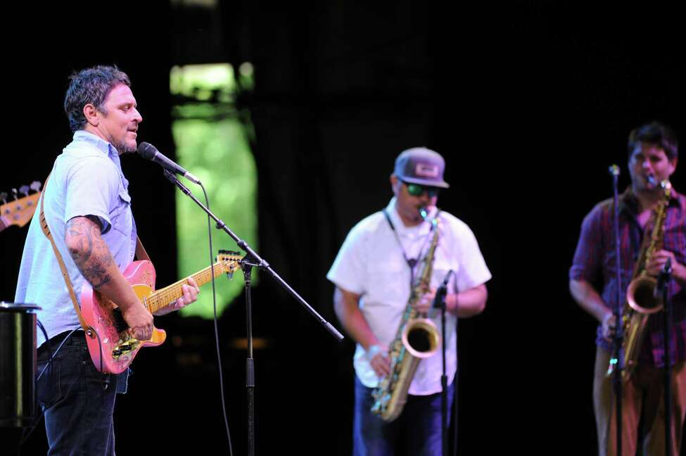 Eric Lindell, left, performs on the main stage with his band during the 39th Freihofer?'s Saratoga Jazz Festival on Saturday June 25, 2016 in Saratoga Springs, N.Y. (Michael P. Farrell/Times Union)