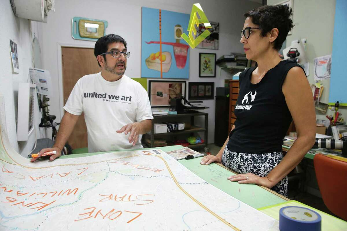 Andy and Yvette Benavides look over the map which shows the 5-square-mile area that comprises Southtown the Arts District.