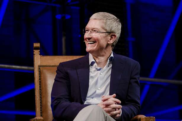 """Tim Cook, chief executive officer of Apple Inc., reacts whilst speaking during the opening of """"Startup Fest"""", a five-day conference to showcase Dutch innovation, in Amsterdam, Netherlands, on Tuesday, May 24, 2016. The Digital City Index for 2015 ranked Amsterdam Europe's second-best city, behind London, for tech startups. Photographer: Marlene Awaad/Bloomberg *** Local Caption *** Tim Cook"""