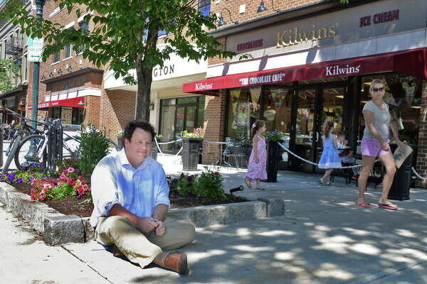 Times Union writer Chris Churchill sits on the sidewalk along Broadway Thursday June 23, 2016 in Saratoga Springs, NY.  (John Carl D'Annibale / Times Union)