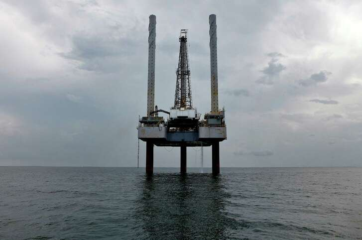 A Hercules Offshore Inc. jackup shallow-water drilling unit stands idle in the Gulf of Mexico off the coast of Cameron, Louisiana, U.S., on Saturday, July 17, 2010. The federal government has imposed a deepwater drilling moratorium and has slowed new shallow water permits in the wake of the BP Deepwater Horizon oil spill. BP Plc's oil spill may cost the U.S. Gulf Coast region 17,000 jobs and about $1.2 billion in lost economic growth by year-end even if the flow is stanched permanently next month, Moody's Analytics said. Photographer: Aaron M. Sprecher/Bloomberg