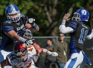 Darien's Andrew Steuber (72) blocks St. Joseph's Brian Harner away from quarterback Timmy Graham (11) during a game on October 10, 2015. Stueber annoucned his commitment to the University of Michigan on Saturday, June 25, 2016.