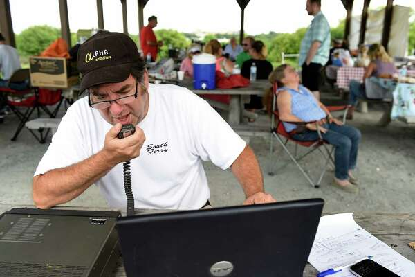 Amateur radio operator Fred Thumhart of Delmar, call sign KB2IXT, left, works a Get on the Air station during the Broughton Field Day on Saturday, June 25, 2016, at Niskayuna Soccer Park in Niskayuna, N.Y. Amateur radio operators in the Capital District and throughout the United States participated in an annual emergency communications preparedness drill. (Cindy Schultz / Times Union)