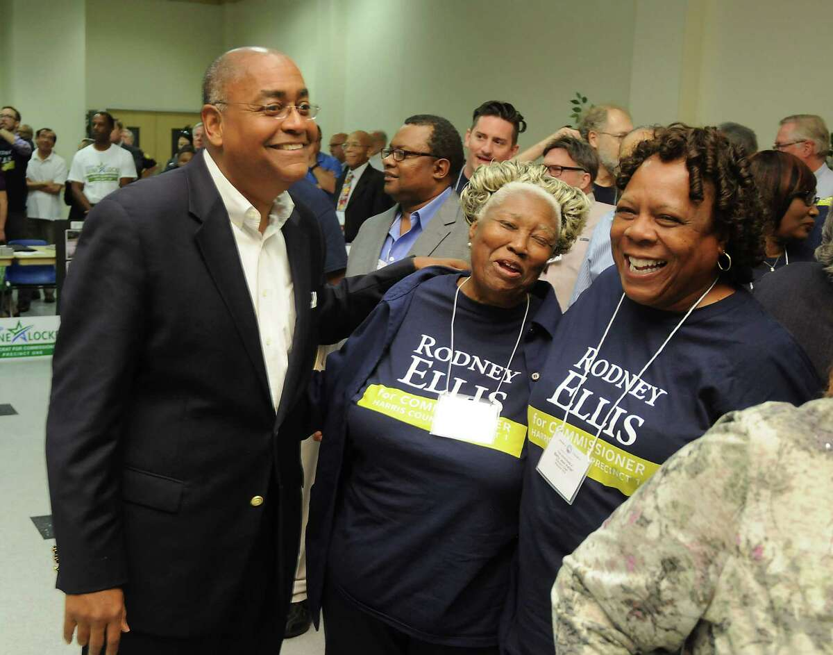 Rodney Ellis chats with Rose Yarborough Cochran and Betty Jean Keller after winning the vote to become the Democratic party nominee Saturday.