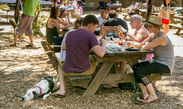 People have beers in the beer garden at the Alpine Inn in Portola Valley, Calif. on June 25th, 2016.