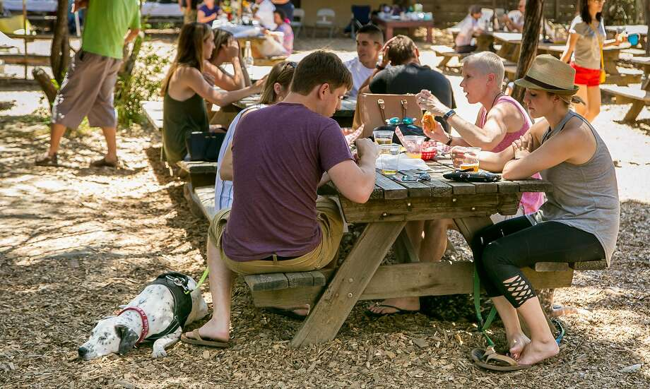 A crowd noshes, sips and relaxes in the beer garden at the Alpine Inn in Portola Valley. Photo: John Storey, Special To The Chronicle
