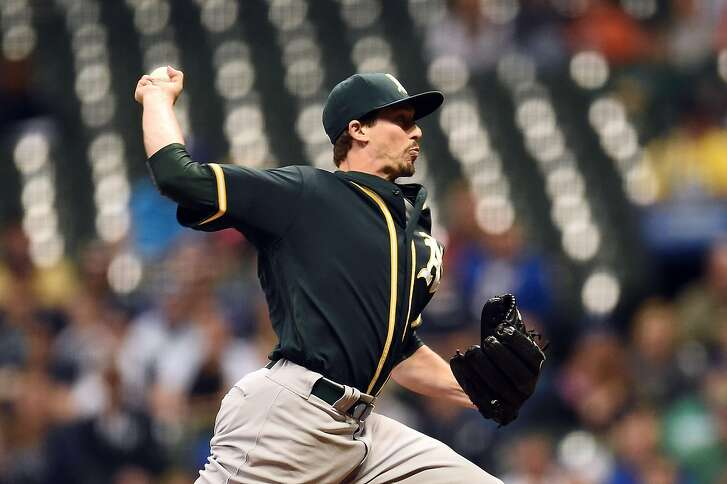MILWAUKEE, WI - JUNE 08:  Ryan Dull #66 of the Oakland Athletics throws a pitch during the sixth inning of a game against the Milwaukee Brewers at Miller Park on June 8, 2016 in Milwaukee, Wisconsin.  (Photo by Stacy Revere/Getty Images)