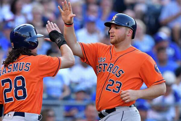 The Houston Astros' Colby Rasmus (28) greets A.J. Reed after both scored on a double by Luis Valbuena in the second inning against the Kansas City Royals on Saturday, June 25, 2016, at Kauffman Stadium in Kansas City, Mo.