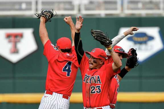 Arizona outfielders Justin Behnke (4), Zach Gibbons (23) and Jared Oliva, right, celebrate their 5-1 win over Oklahoma State in an NCAA men's College World Series baseball elimination game in Omaha, Neb., Saturday, June 25, 2016. (AP Photo/Ted Kirk)