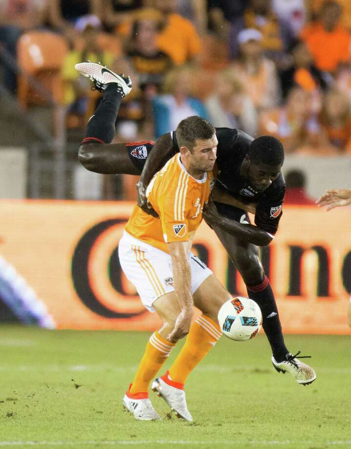The Dynamo's Will Bruin, left, has scored four goal in his last four games against Portland. He hopes to end his current scoring drought in today's match against the Timbers. Photo: Juan DeLeon, FRE / Houston Chronicle